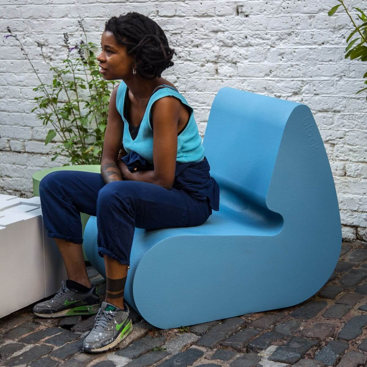 Block_lounge-chair_blue_girl_yard-sq