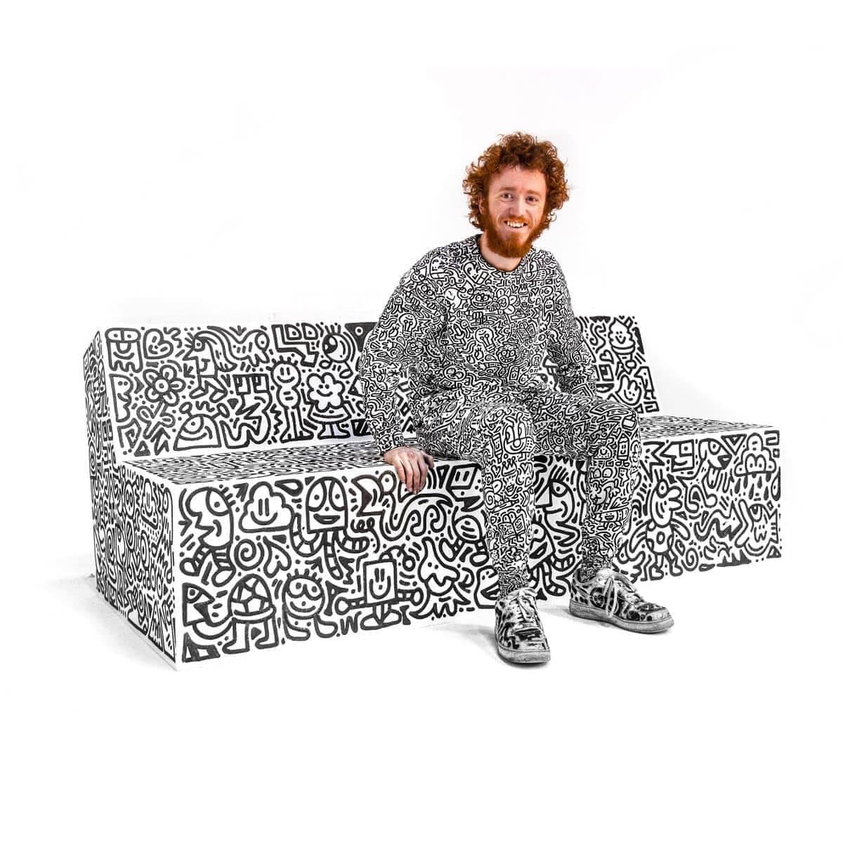 mr-doodle-sits-on-block-slab-bench